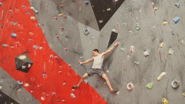 Thumbnail for Challenge for Young Man on the Climbing Wall