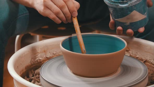 Thumbnail for Pottery - the Man Is Painting a Clay Bowl Inside
