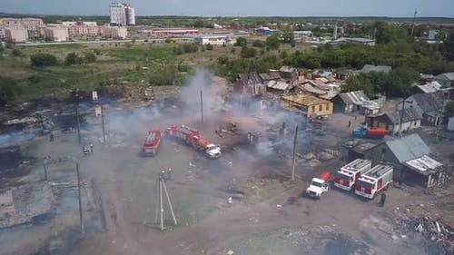 Firefighters Are Extinguishing Fire in Village, Fire Engines, Aerial Shot