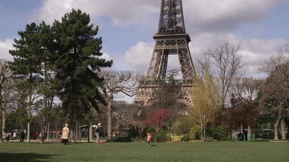 Thumbnail for Eiffel Tower with trees in the foreground.