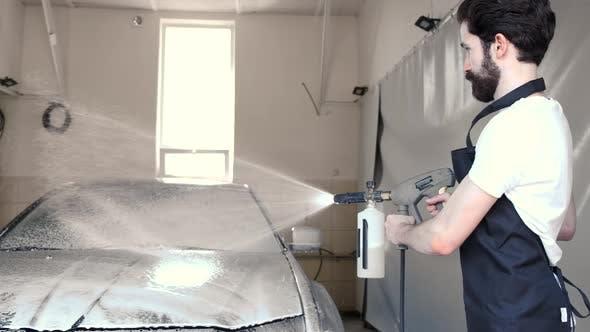 Thumbnail for Man Washing His Car in a Garage