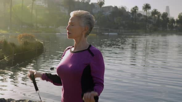 Thumbnail for Senior Woman Working Out In The Park