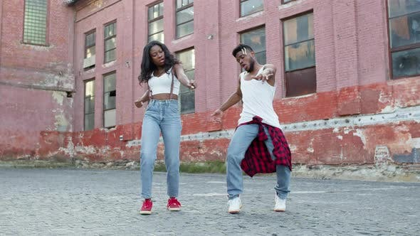 Thumbnail for Black Guy And Girl Dancing Modern Street Dancing.