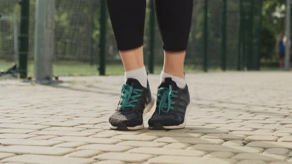 Close Up of Female Feet Jumping Rope
