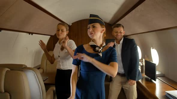 Thumbnail for Businesspeople Dancing Inside of Aircraft First Class