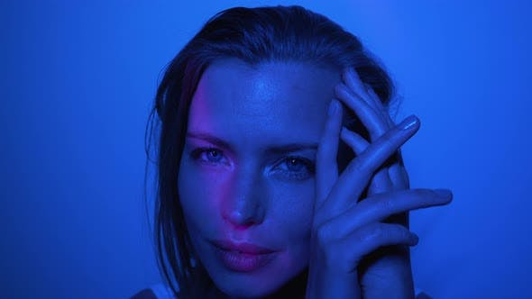 Thumbnail for Model Doing Different Facial Poses in a Dark Room