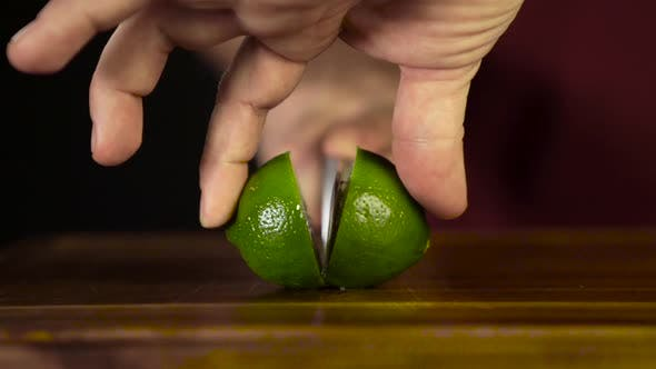Cover Image for Hands Cut Lime with a Knife