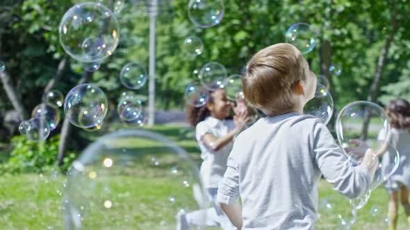 Thumbnail for Joyous Kids Catching Soap Bubbles