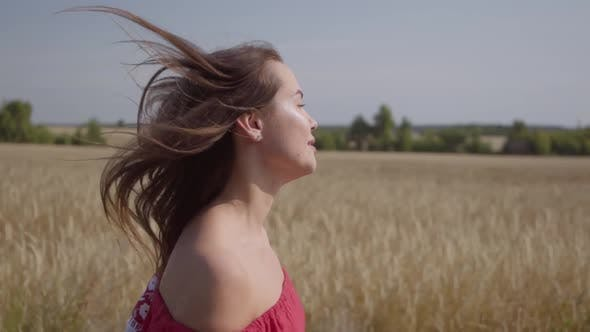 Thumbnail for Side View of Beautiful Carefree Woman with Long Hair Running Through the Wheat Field, Hair