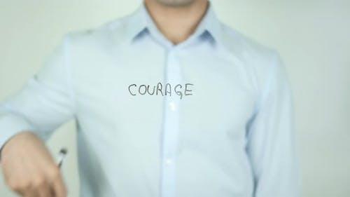 Courage, Man Writing on Screen