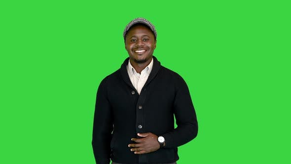 Handsome Black Man Smiling for the Camera on a Green Screen Chroma Key