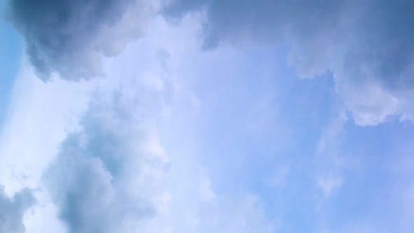 Seamless Loop Fluffy Clouds in Blue Sky in Summer Shot on a Sunny Day