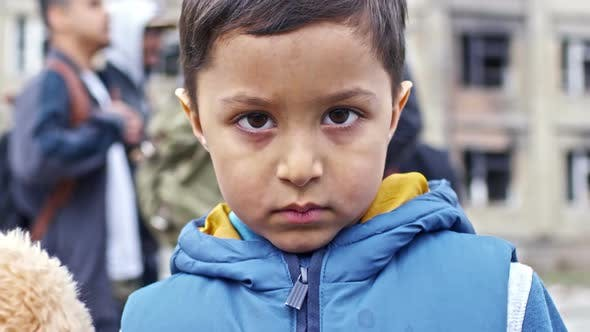 Cover Image for Sad Little Refugee Boy with Plush Toy