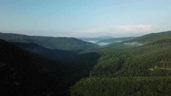 Thumbnail for Aerial Landscape View of Caucasus Mountain at Sunny Morning with Fog