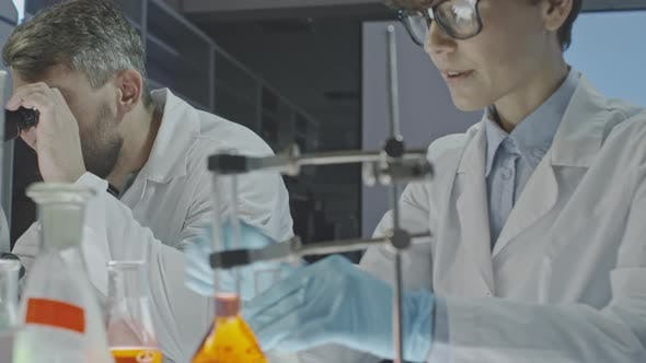 Thumbnail for Scientists Mixing Solutions in Laboratory
