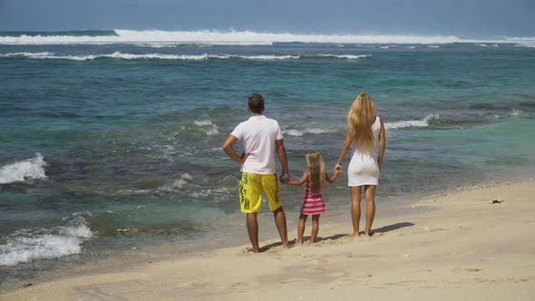 Thumbnail for Family with Child on the Beach.