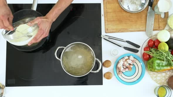 Thumbnail for Adding Cream Sauce to Frying Bacon