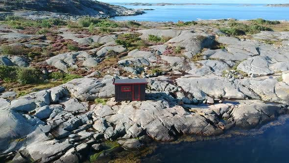 Thumbnail for Aerial Drone Shot of A Cabin at A Rocky Ocean Coastline