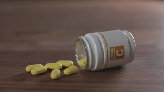 Thumbnail for Vitamin C Pill on a Brown Table