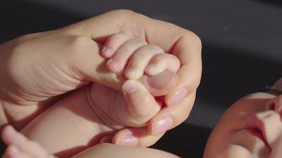Parent Holding Cute Babys Hand