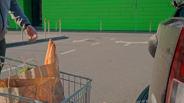 Thumbnail for Guy with Shopping Cart Near Store