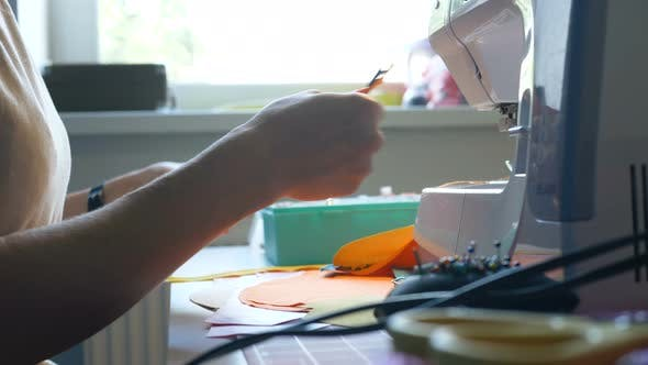 Thumbnail for Seamstress Hands Hold Fabric and Cut Thread with Scissors