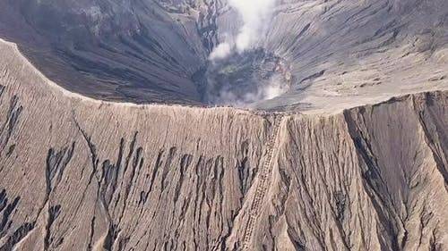 Active Volcano and Tourists on the Caldera