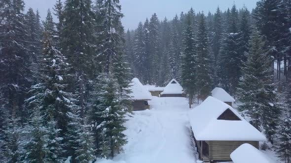 Thumbnail for Flying Over Wooden Houses in Winter