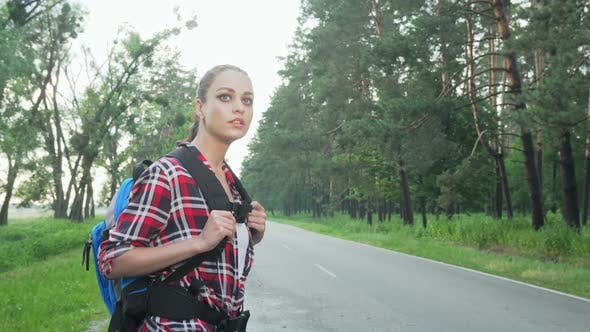 Thumbnail for Charming Woman with Backpack Hitchiking on Countryside Road