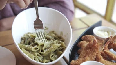 Cooked Pasta with Pesto in a Bowl