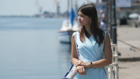 Thumbnail for Chic Brunette Girl Standing and Waiting for Her Mr.Right at Dnipro in Slo-mo