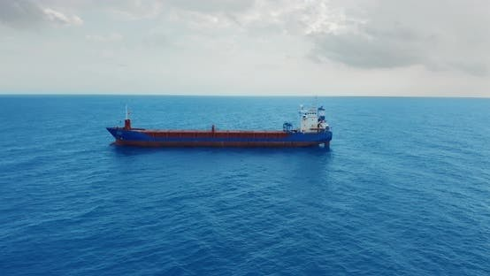 Freight Ship Floating on Sea. Aerial View.