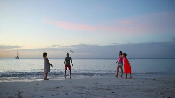 Thumbnail for Happy Family Playing with Flying Disk at Beach at Sunset