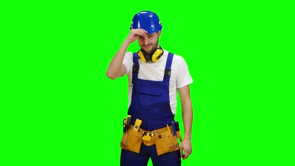 Thumbnail for Builder Wears a Hard Hat and Smiles. Green Screen