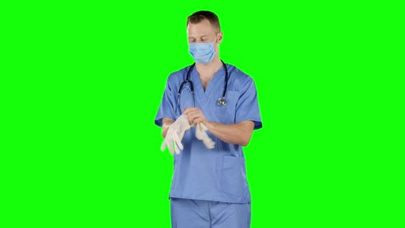 Thumbnail for Healthcare Worker Putting on Medical Gloves. Green Screen