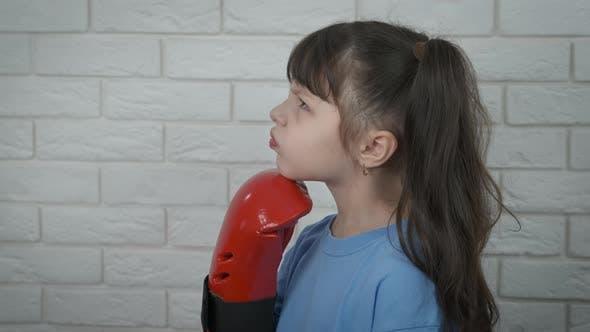 Child in Red Box Gloves
