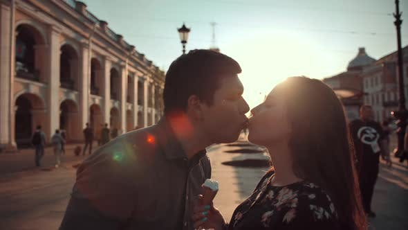 Thumbnail for Happiness Couple with Ice Cream Under Sunlight at Evening Sunset