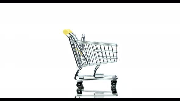 Thumbnail for Empty Shopping Cart in Motion Isolated on White Background, Copy Space