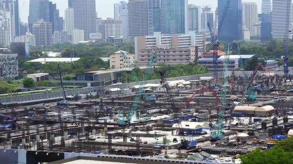 Panoramic View of Cityscape and Construction Site in Metropolis
