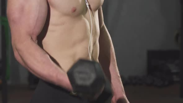 Thumbnail for Muscular Man with Stunning Body Lifting Dumbbell