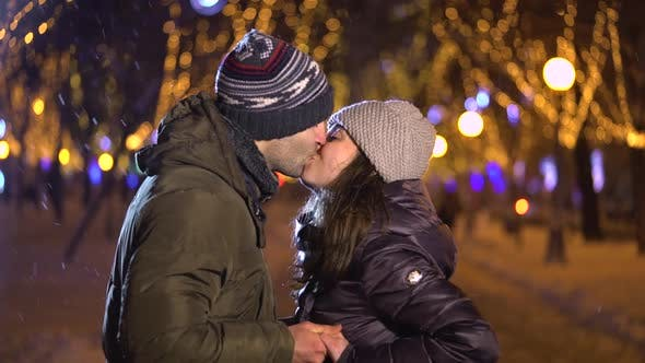 Thumbnail for Happy Romantic Couple Kissing at Christmas