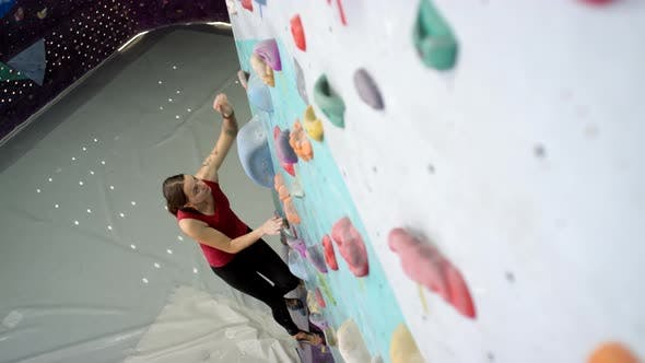 Thumbnail for Caucasian Woman Climbing up Vertical Wall at Gym