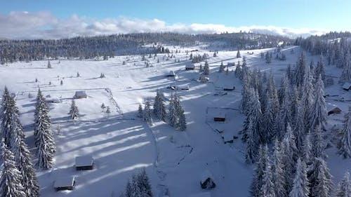 Mountain Village Buried Under Snow at Winter