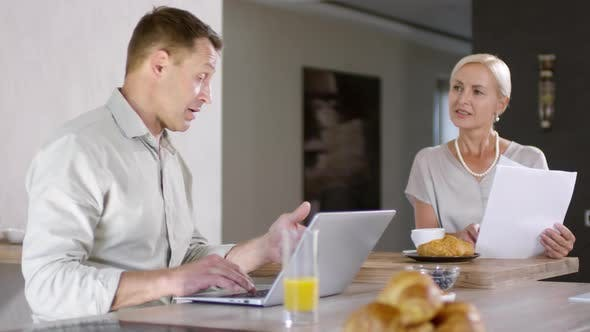 Thumbnail for Happy Caucasian Couple Having Breakfast and Paying Bills on Laptop