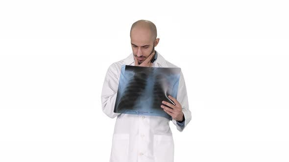 Thumbnail for Doctor Radiologist Looking at X-ray Scan Walking on White Background.