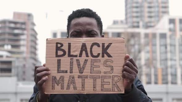 African American Man Hands Hold Poster Black Lives Matter