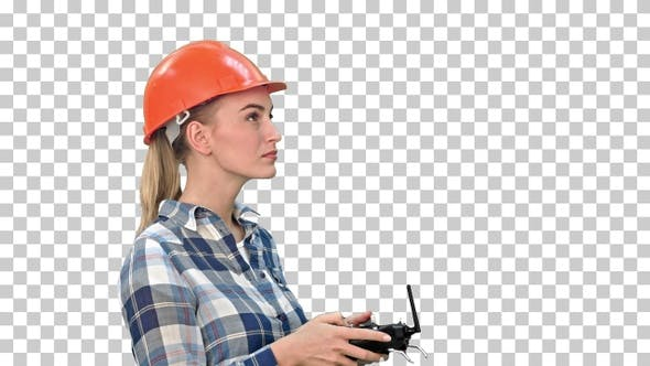 Female engineer operating a drone analyzing object, Alpha Channel