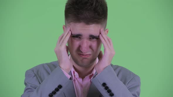 Thumbnail for Face of Stressed Young Businessman Having Headache