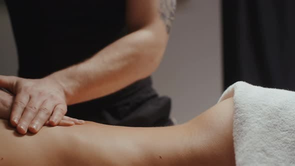 Cover Image for Woman Receiving Lower Back Massage Rejuvenating Procedure in Spa Male Chiropractor Doing Orthopaedic
