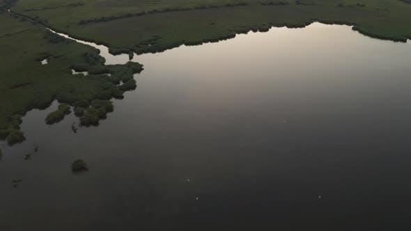 Thumbnail for Drone Flight Over Floodplain To Sea Coast at Dusk